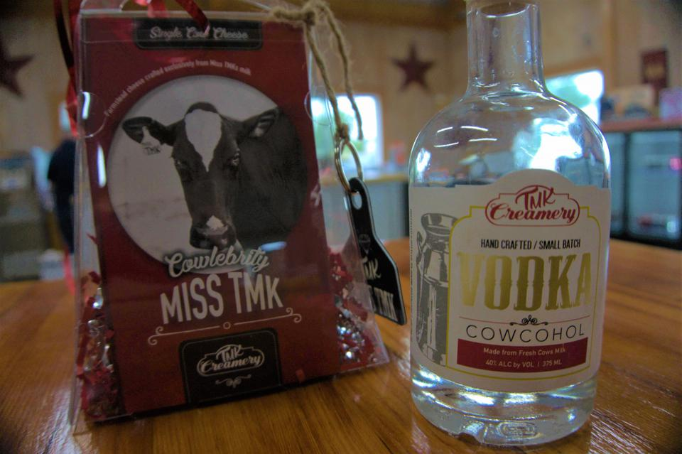 A bottle of Cowcohol and a package of TMK Single Cow Cheese