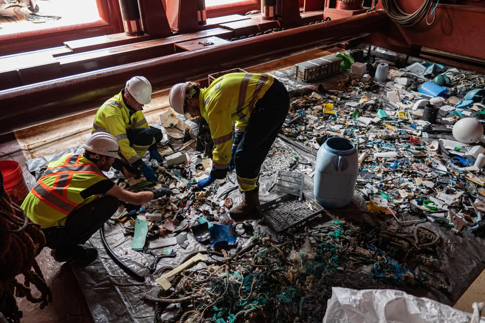 crew sort plastic ocean cleanup