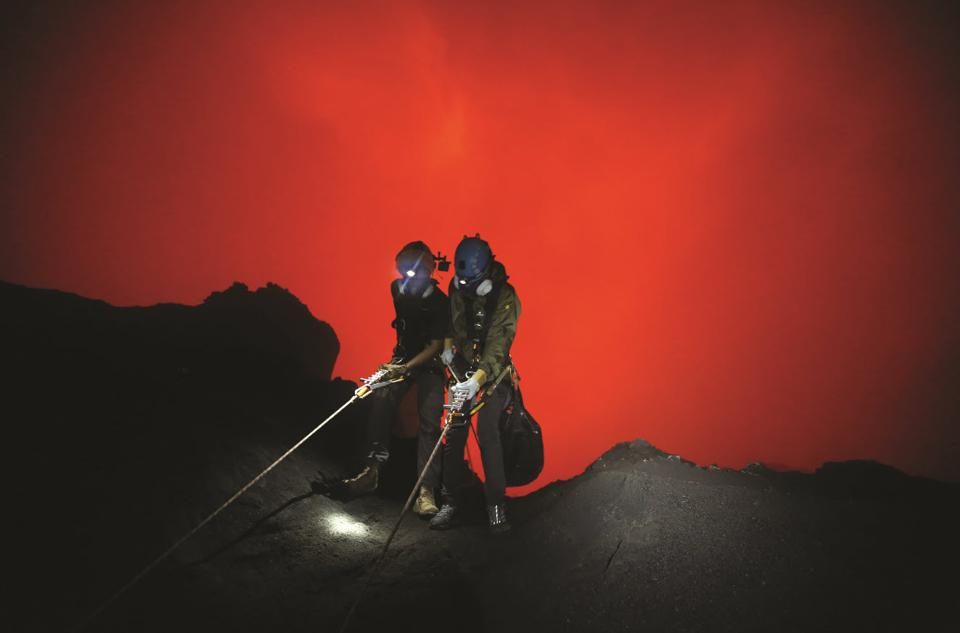 Extreme abseil over the edge of one of the world's last unexplored craters to photograph a bubbling lava lake.