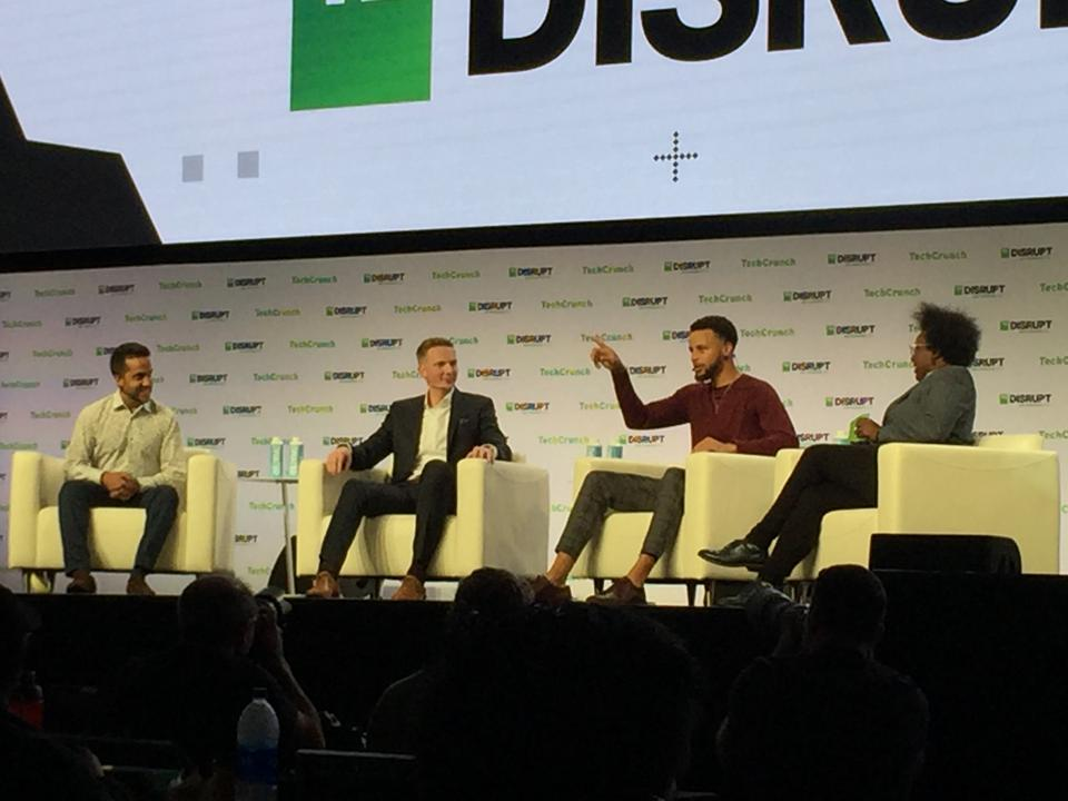 SnapTravel's Hussein Fazal on stage with Steph Curry, Bryant Barr and TechCrunch's Megan Dickey at Disrupt SF