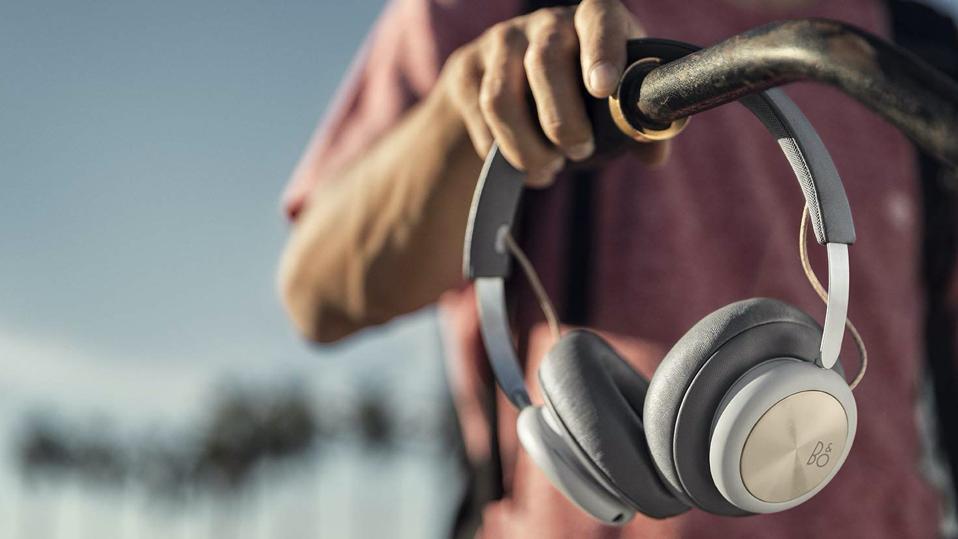 Gray B&O Beoplay H4 headphones on bicycle handlebars.
