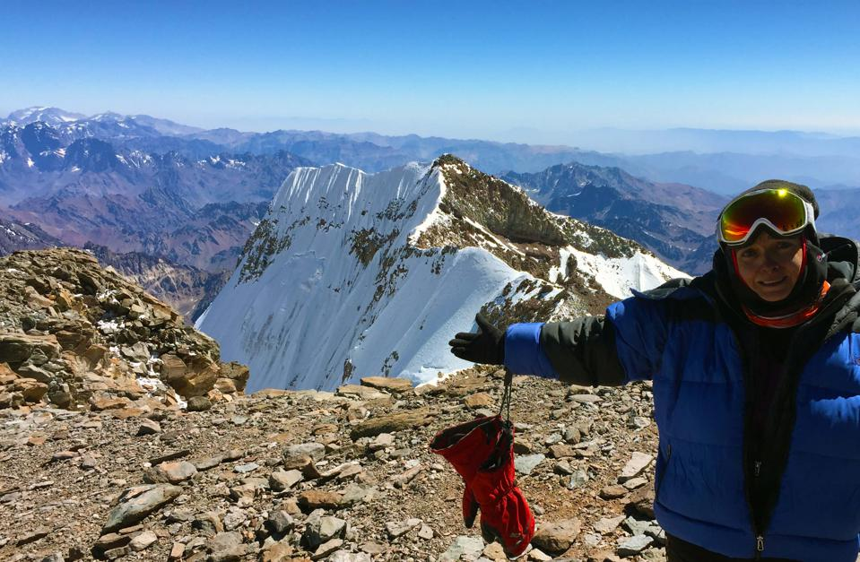 My friend at Aconcagua Summit. I didn't make it due to the altitude sickness and being too slow. But I was very proud of myself for reaching 21,325 feet as my second high-altitude mountain.