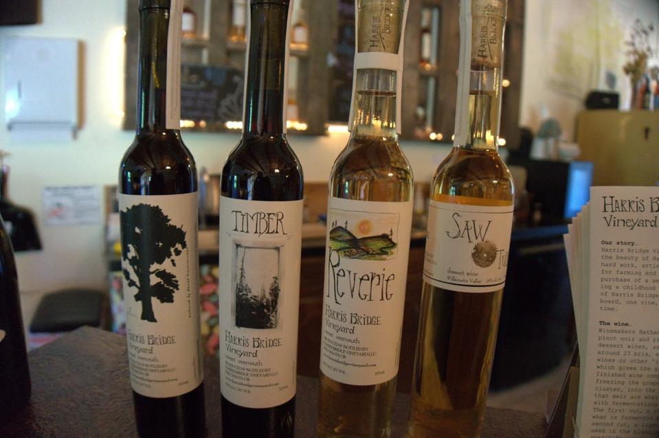 A line up of bottles and at Harris Bridge Vineyard