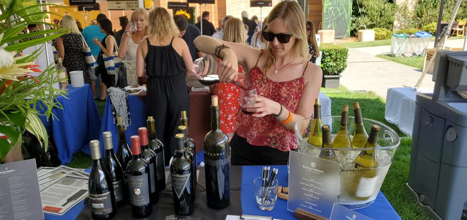 woman pouring wine at Taste of Sonoma