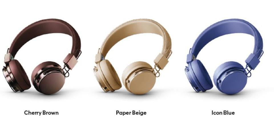 Three pairs of headphones in different colors.