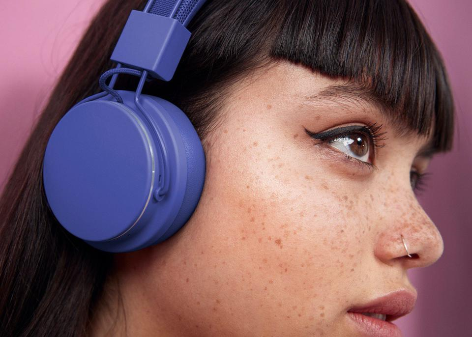 Young woman wearing blue headphones