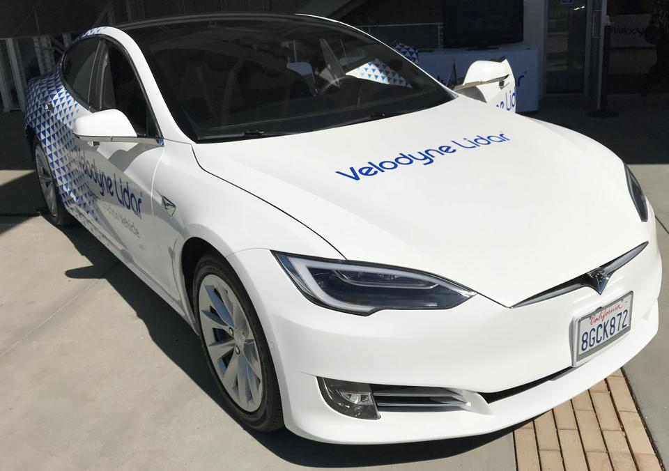 Tesla with a Veloydyne LIDAR unit mounted underside the windshield.