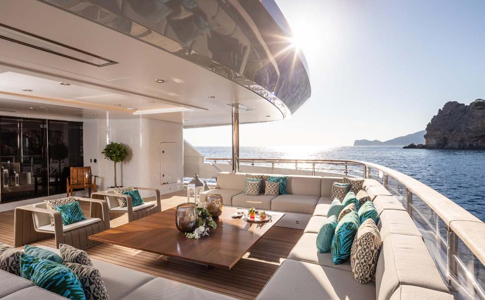 The spacious and comfortable aft deck aboard the Benetti Metis