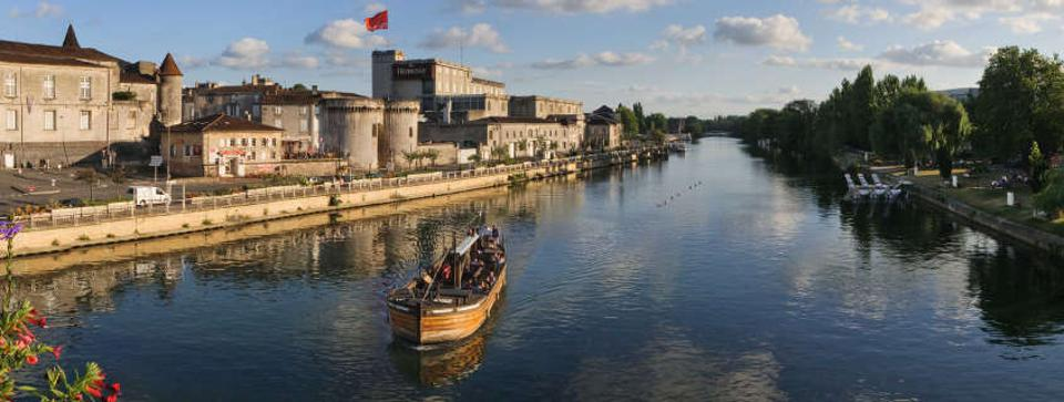 The Charente River flows through Cognac and is lined with several Cognac producers' chateaux.