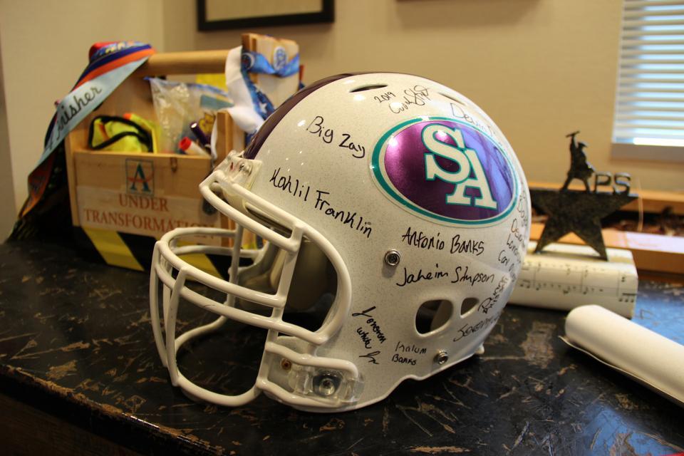 Dr. Carstarphen proudly displays a signed team helmet on her desk
