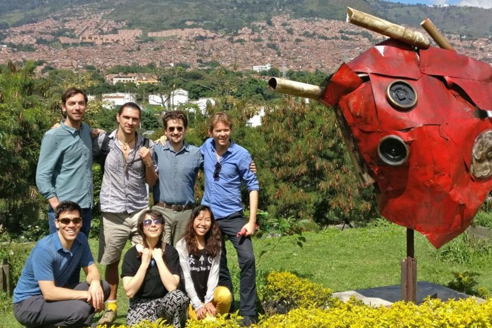 The MovingWorlds team poses on a hillside.