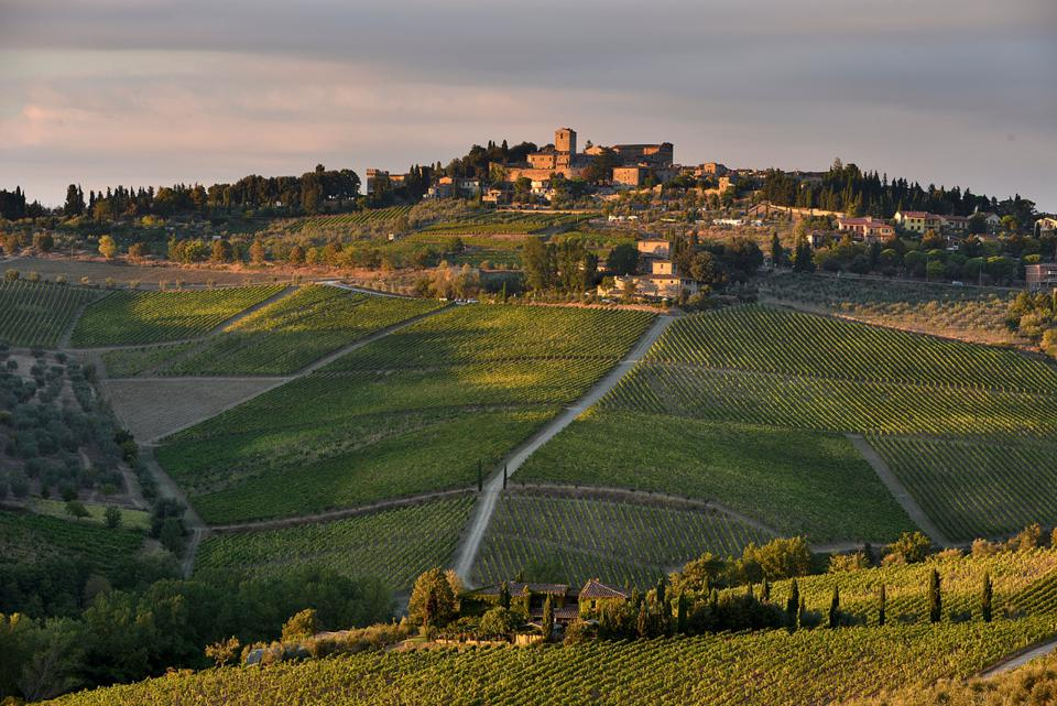 The village of Panzano in Chianti sits on a hilltop amid the hills of vines at the heart of Tuscany
