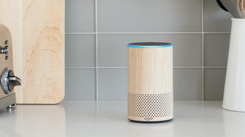 Oak 2nd-generation Amazon Echo on a kitchen counter.