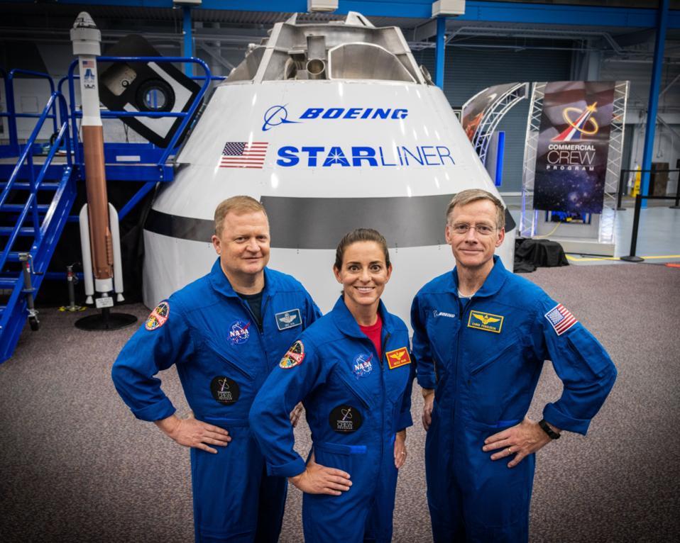 From left, astronauts Eric Boe, Nicole Mann and Chris Ferguson near Boeing Starliner.