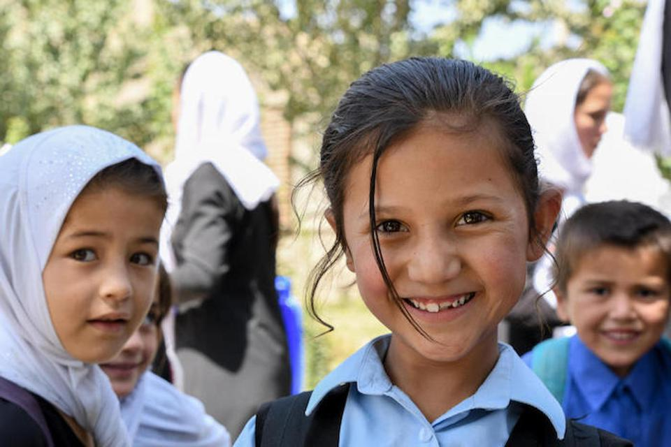 Primary students take a break on the playground at UNICEF-supported Turgani High School in Faizabad, a northeastern province of Afghanistan, in August 2019.