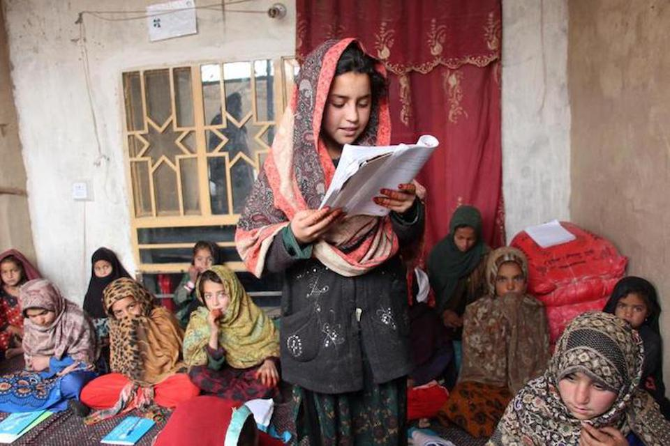Twelve-year-old Wasilla (center) is enrolled in the 3rd grade at a UNICEF-supported accelerated learning center (ALC) in Kotal Morcha village, Kandahar province.