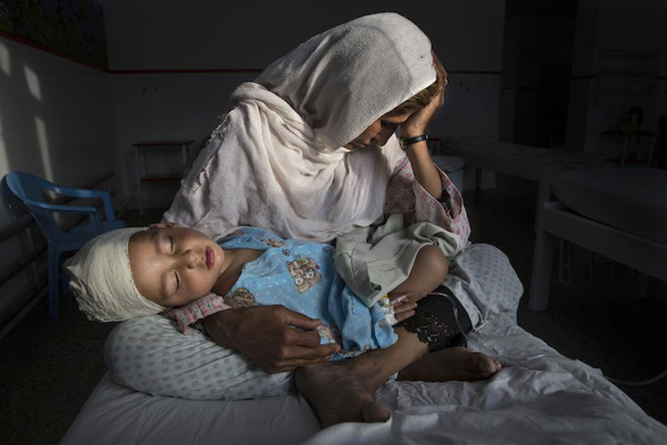 Najiba holds her nephew Shabir, 2, who was injured in a bomb blast that killed his sister in Kabul, Afghanistan in March 2019.