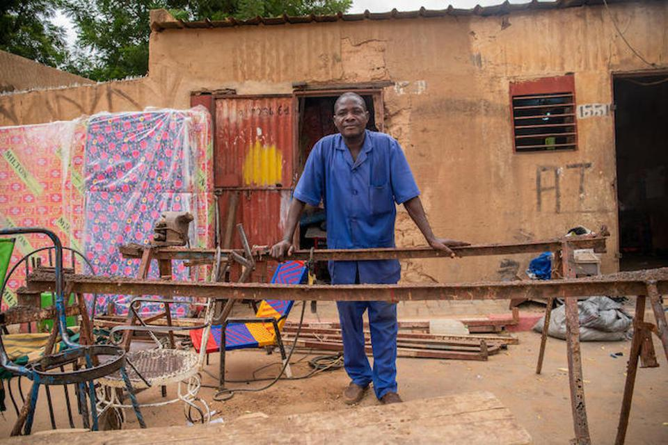 At his welding shop in Niamey, Pascaline's father, Henri, says the neighborhood boys respect his daughter's soccer skills.