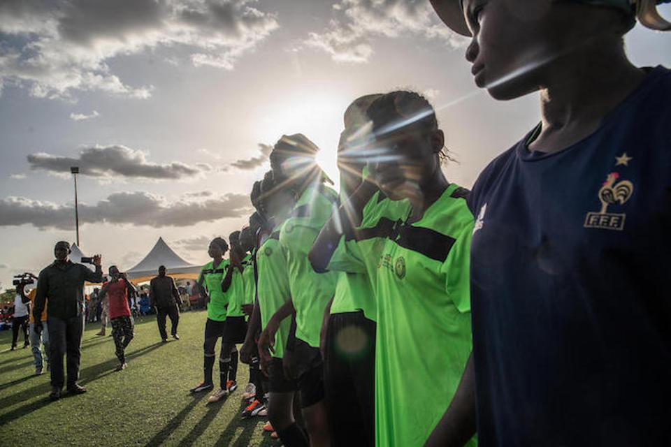 Pascaline and her teammates line up before the start of a tournament organized by the Nigerien Football Federation, with support from UNICEF.
