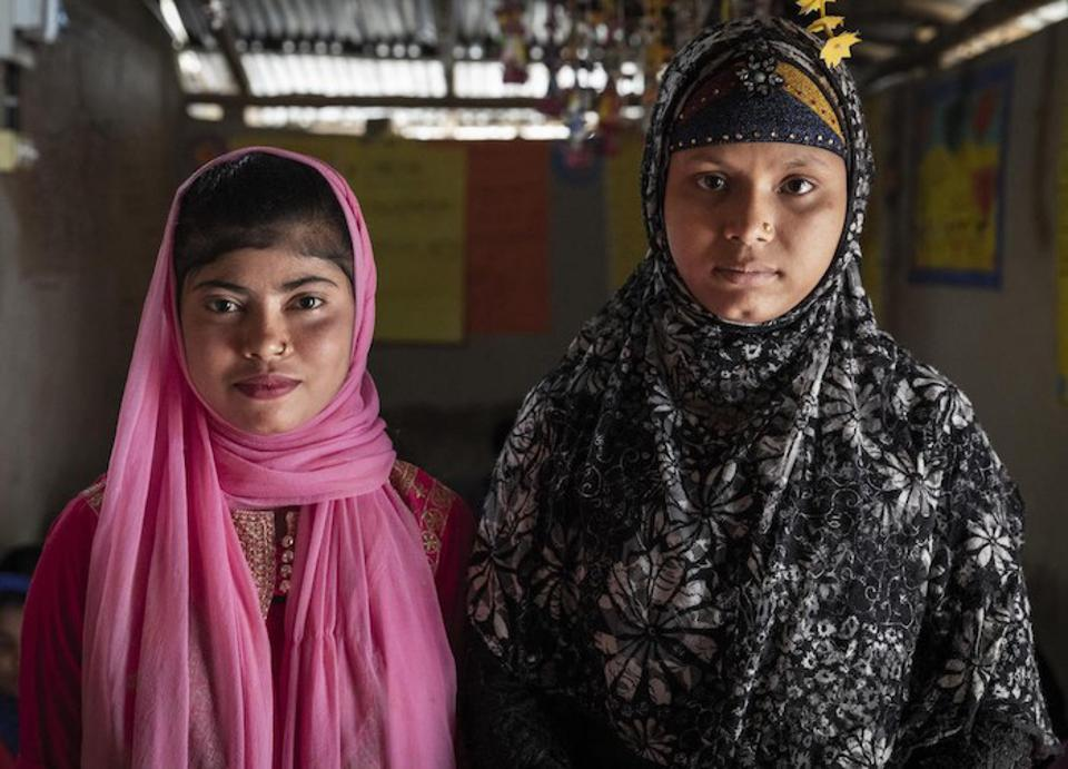 12-year-old Yasmin (left), a Bangladeshi national, and Showkat, 15, a Rohingya refugee, both attend a UNICEF-supported adolescent club in Lambasia refugee camp, Cox's Bazar, Bangladesh on June 24, 2019.