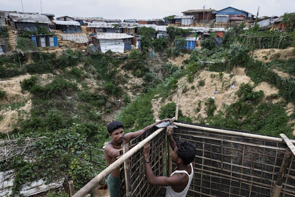 Concerned for the safety of their mother and sister, brothers Imam (left), 27, and Jahiruddin Hosain, 21, built a bathroom for their family members in the hilly Hakimpara Rohingya refugee camp in Cox's Bazar, Bangladesh.