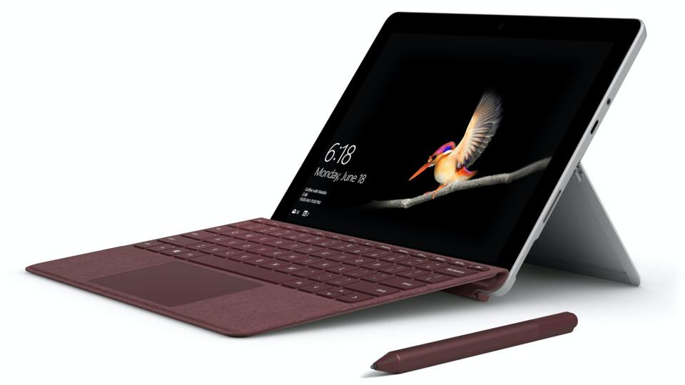Microsoft Surface Go with keyboard cover and stylus.