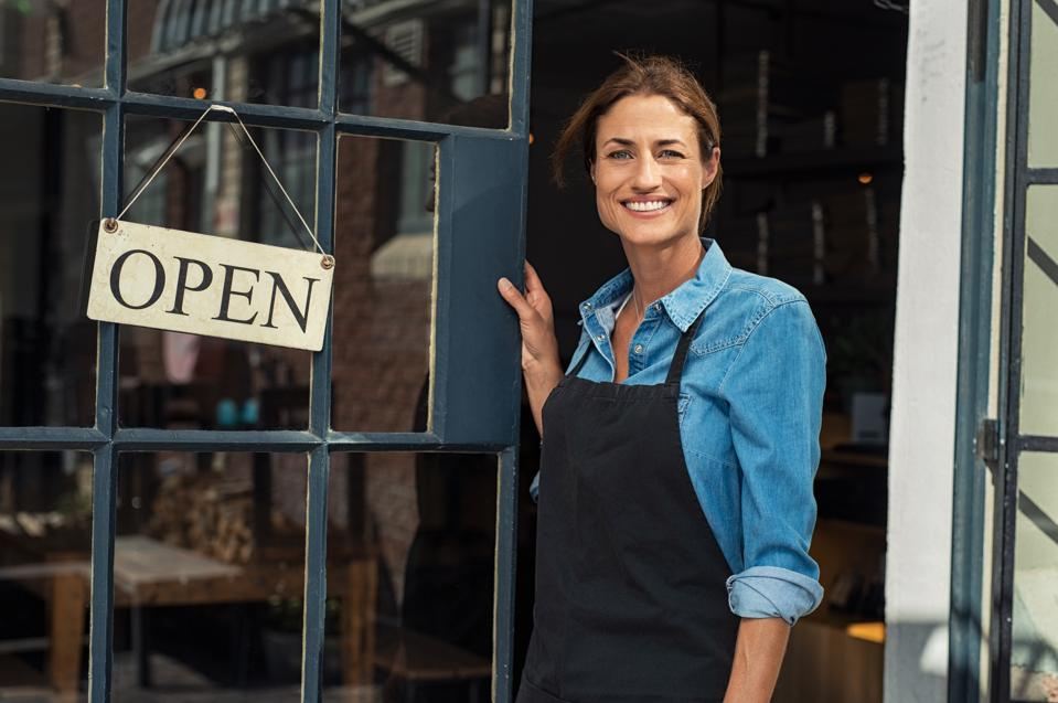 Woman at small business entrance