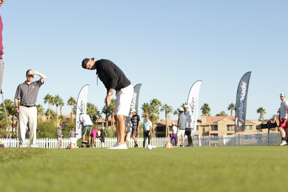 a golfer admires his shot during a major series of putting event