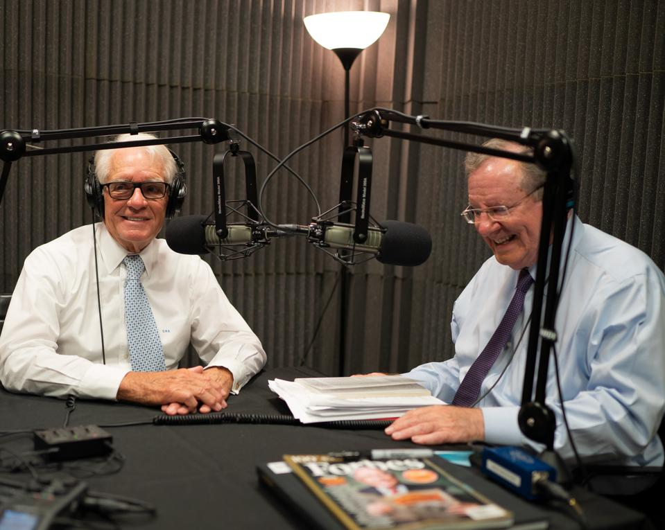 Charles Schwab and Steve Forbes recording the podcast ″What's Ahead″