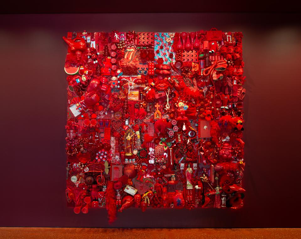 Installation view of 'Waking Dream,' featuring Linda Pace, 'Red Project,' 2001. Red found objects on wooden panels. 96 x 96 in.