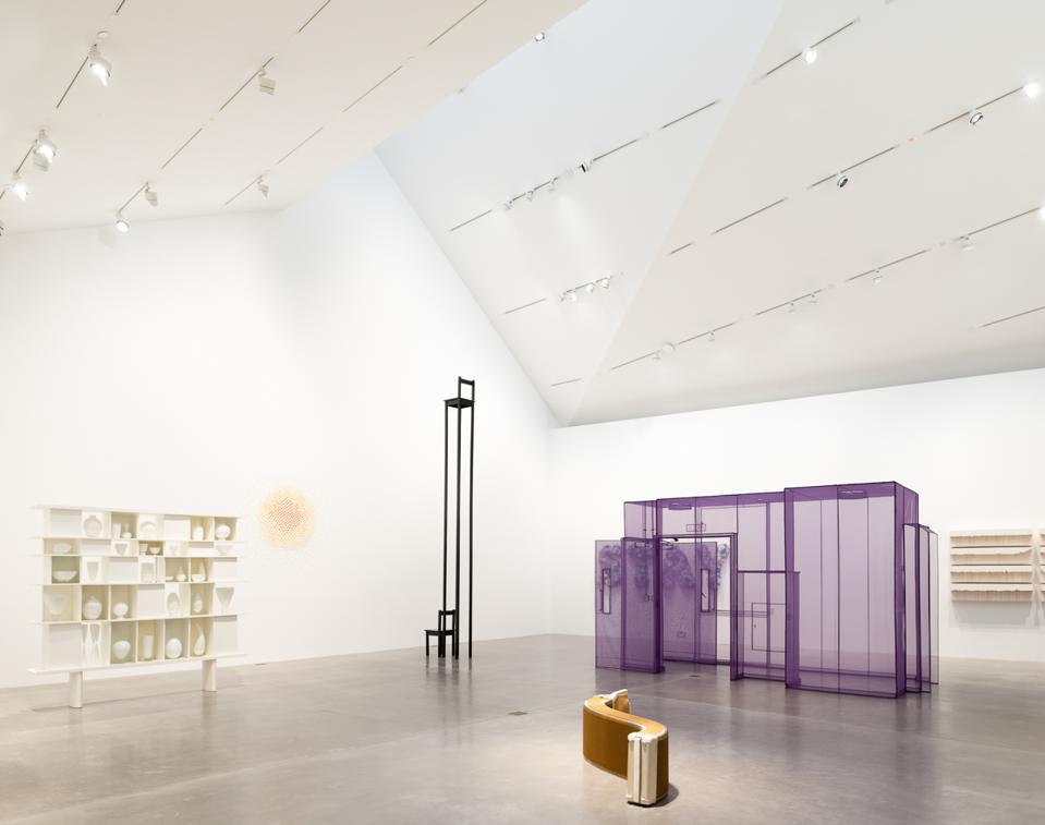 Installation view of 'Waking Dream,' featuring Marina Abramovic, 'Chair for Man and His Spirit,' 1993. Iron. 197 x 16 x 16 in.