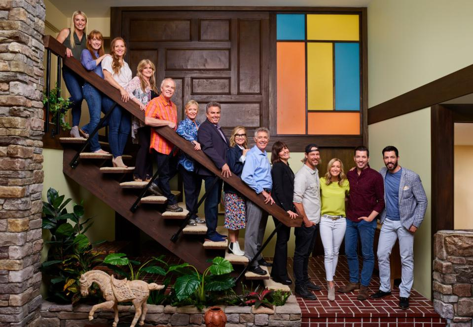 The Brady Bunch cast and HGTV stars stand on the iconic stairs