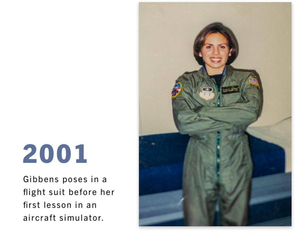 2001: Gibbens poses in a flight suit before her first lesson in an aircraft simulator.