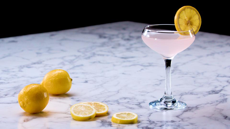 pink cocktail with lemons