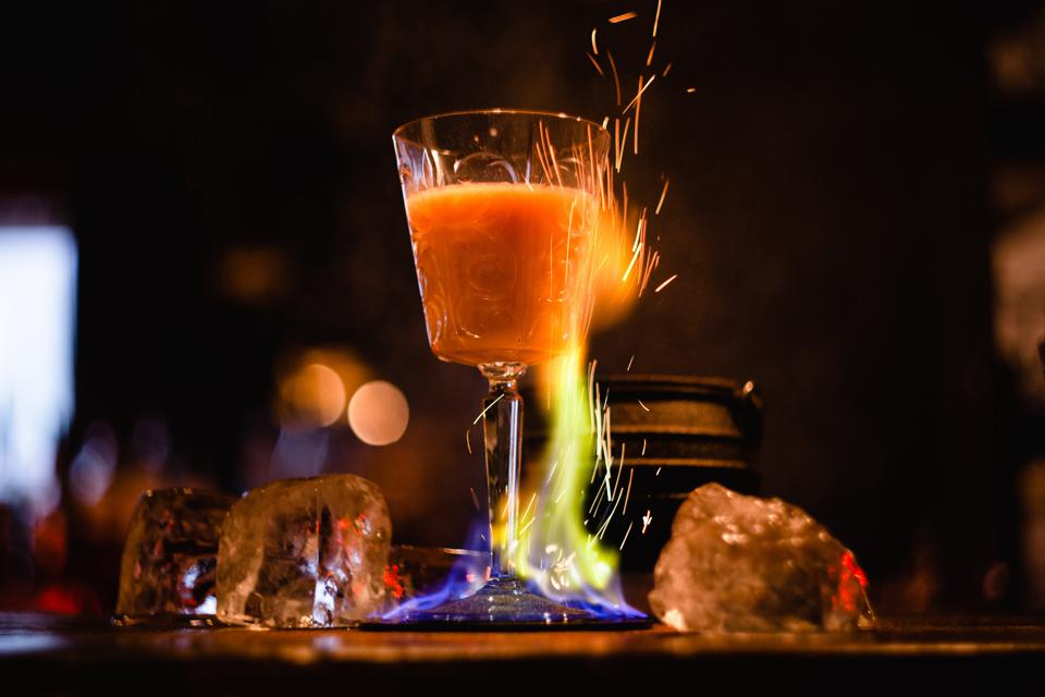 Sweet Agony, a flaming brandy cocktail made with Courvoisier VSOP, Creme de Cacao White, Half & Half, Vanilla Liquor, a pinch of salt and a spark of fire.