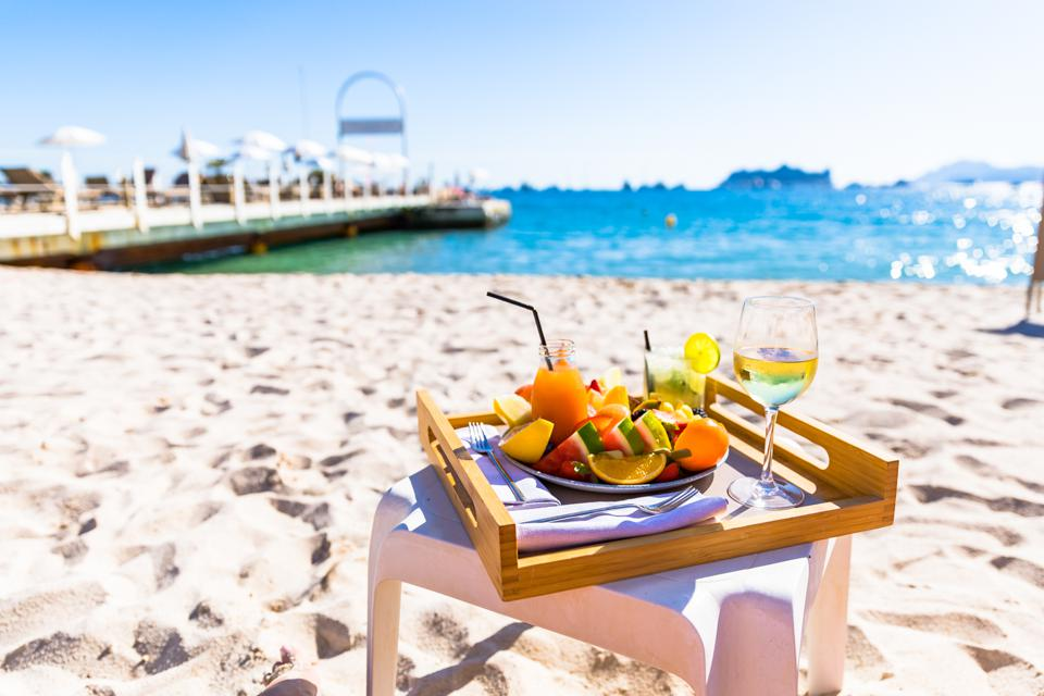 Cannes, France - A platter of fruit and some drinks at Palais Stephanie Plage in Cannes