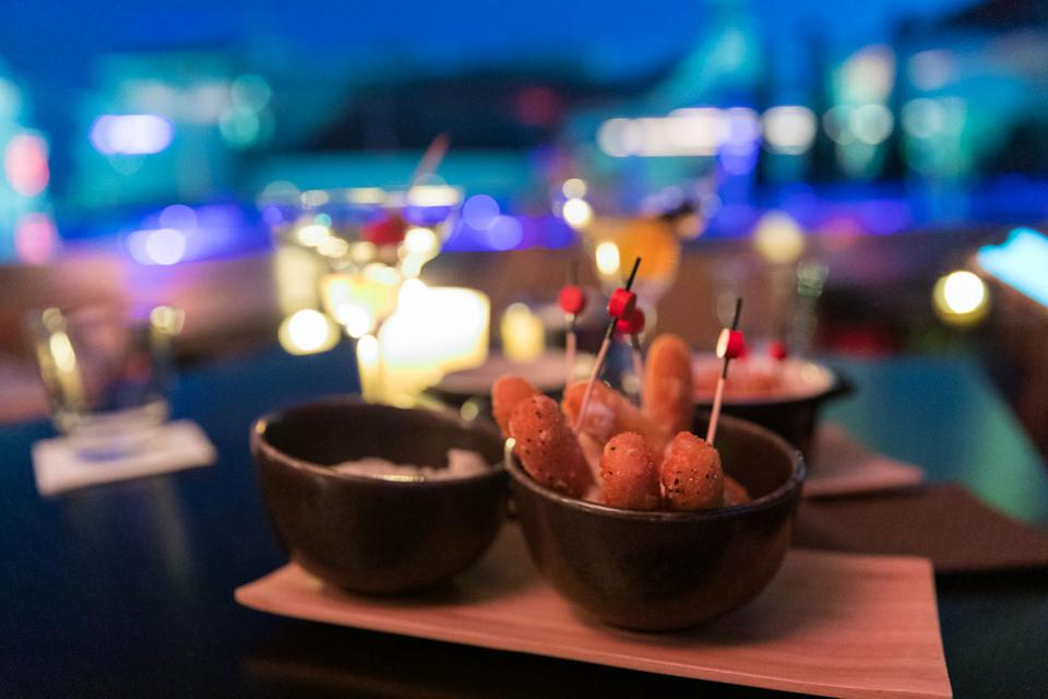 Cannes, France - Some snacks near the pool at Le Roof at the Five Seas Hotel