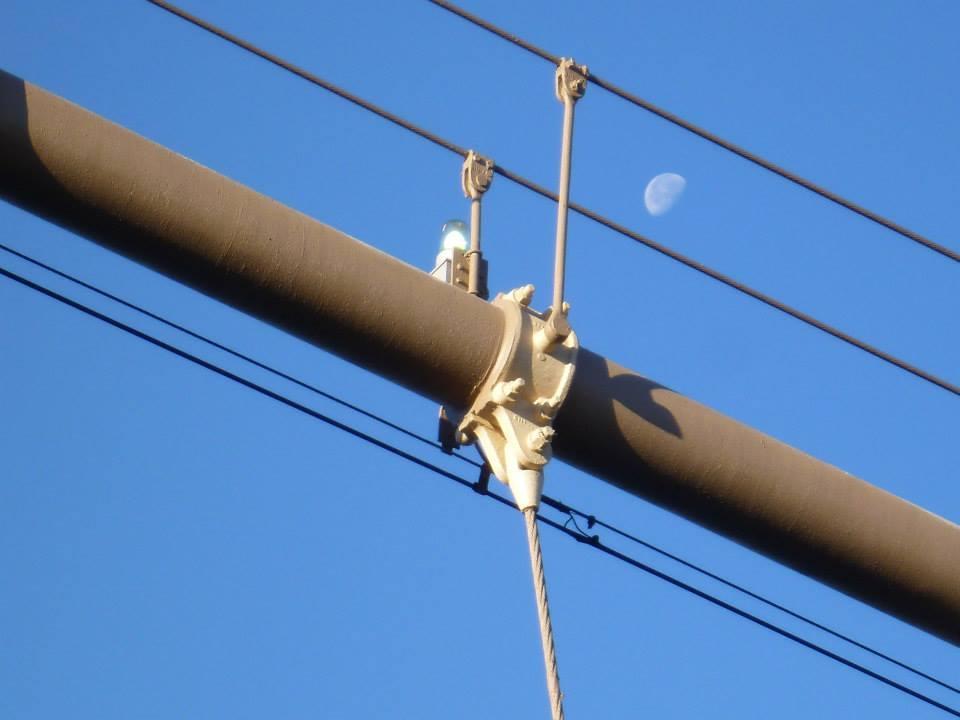 A daytime moon from Brooklyn Bridge, New York City.