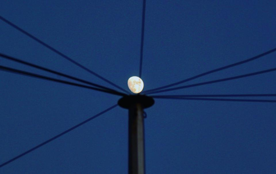 The moon on a stick. This was taken when the moon was nearly full, when it rises a few hours before dusk.