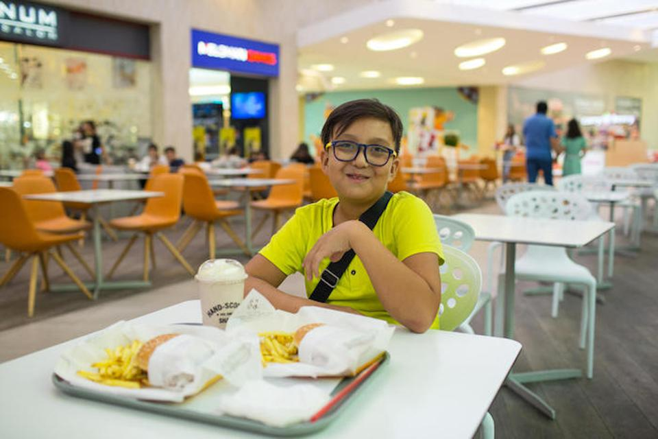 ″This kind of lifestyle causes diseases like liver cancer, I think,″ said 10-year-old Yerzhan, posing with his fast-food lunch — two hamburgers with fries and a milkshake — In Almaty, Kazakhstan.
