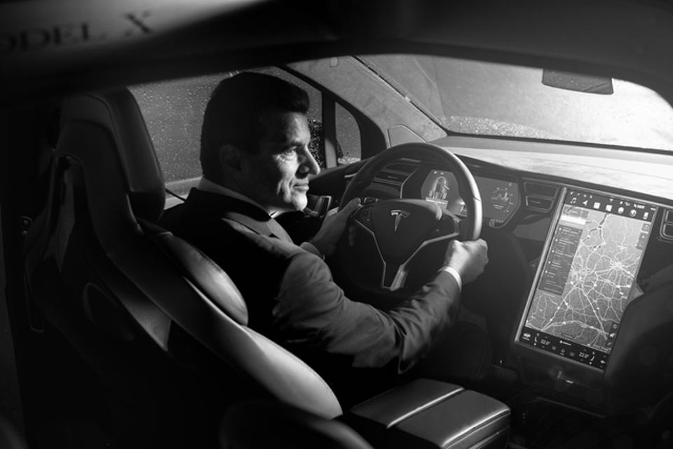 A chauffeur in the driver's seat.