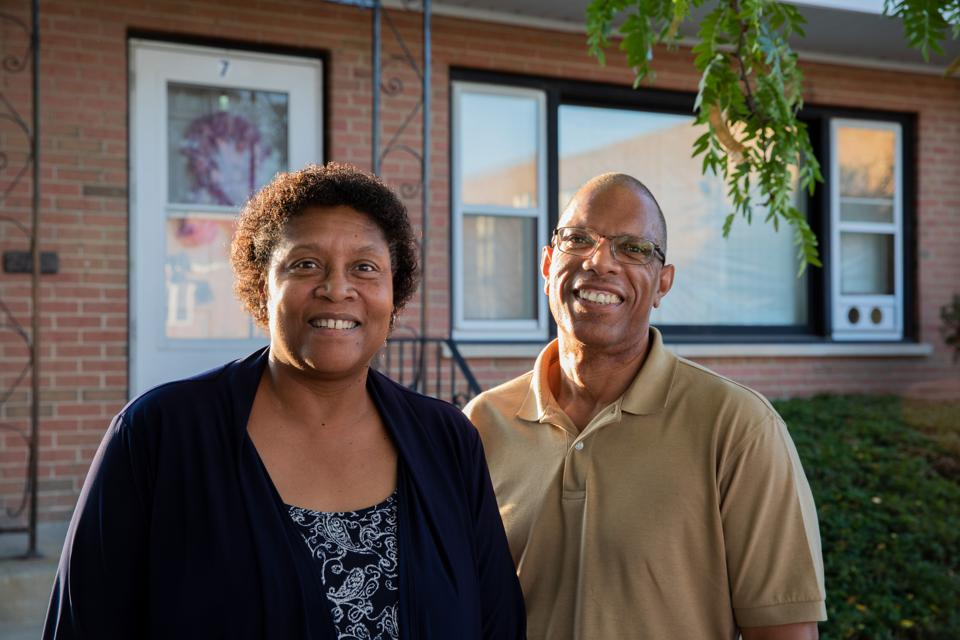 Robert and Dorice Pierce stand in front of their apartment building.