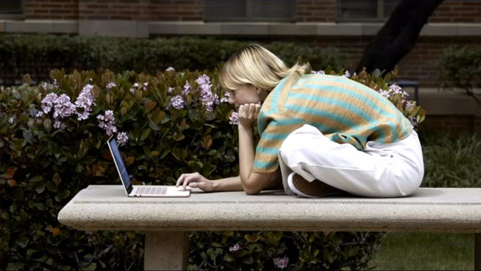Woman on a bench working on a Pixelbook.