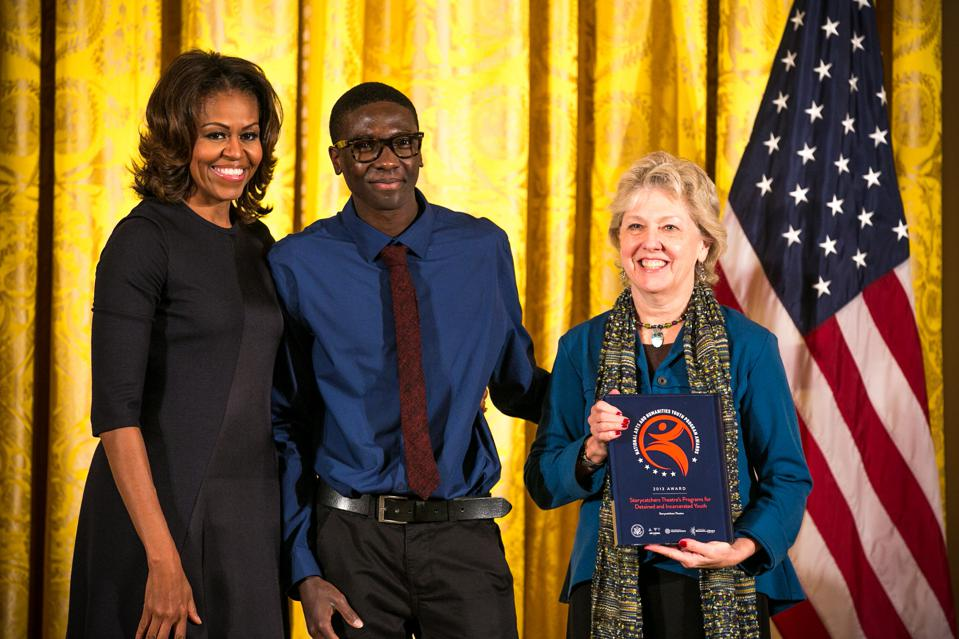 First Lady Michelle Obama presented Meade Palidofsky and a Storycatchers youth with a National Arts and Humanities Youth Program Award from the President's Committee on the Arts and Humanities in 2013.
