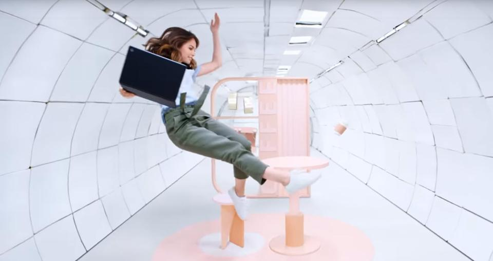 Woman floating weightless with a Pixelbook Go