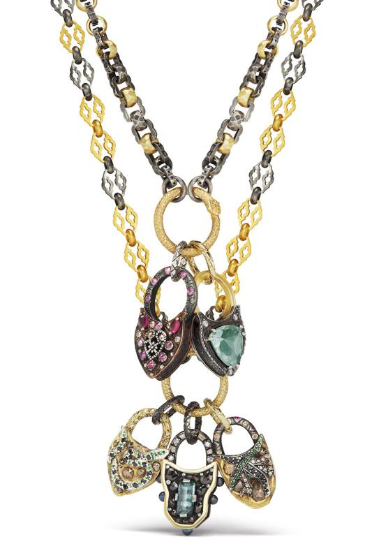 Infinity Lock pendants by Castro NYC, on chains designed in collaboration with Stella Flame Jewelry, 18kt gold and other precious metals, diamonds and various gemstones.