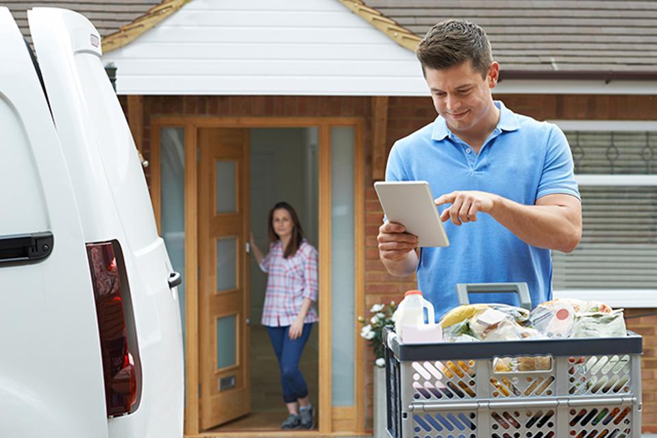 Driver delivering groceries uses Visa Direct.