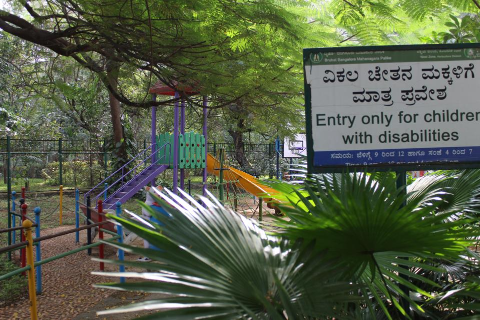 A playground whose sign reads ″Entry only for children with disabilities″