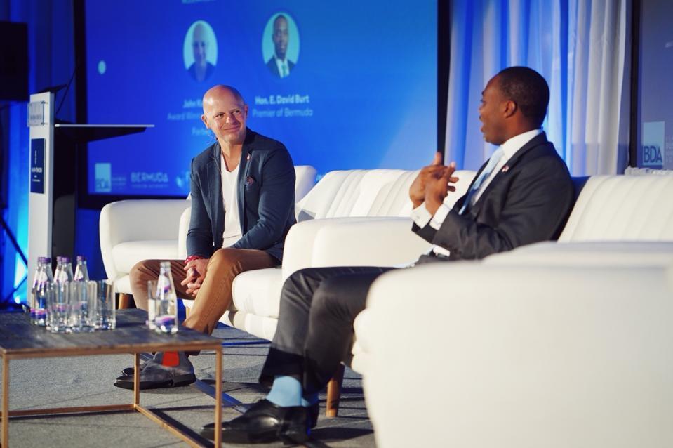 Bermuda Premier Hon. E David Burt with John Koetsier on-stage at TechBeach Retreat in Hamilton, Bermuda.