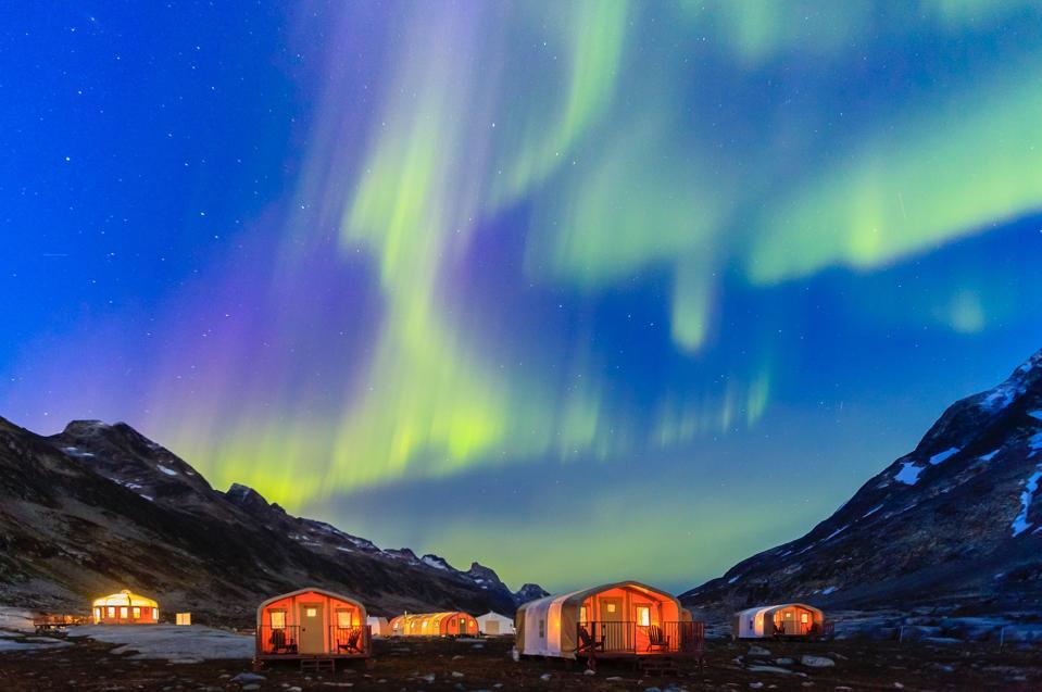 Northern Lights dance over Natural Habitat Adventures' East Greenland Base Camp.